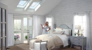 Woman standing below a roof skylight
